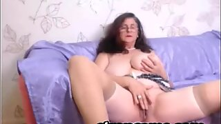 Old busty woman plays with her weet pussy