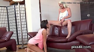 Sweet lesbian kittens get splashed with piss and splash wet snatches